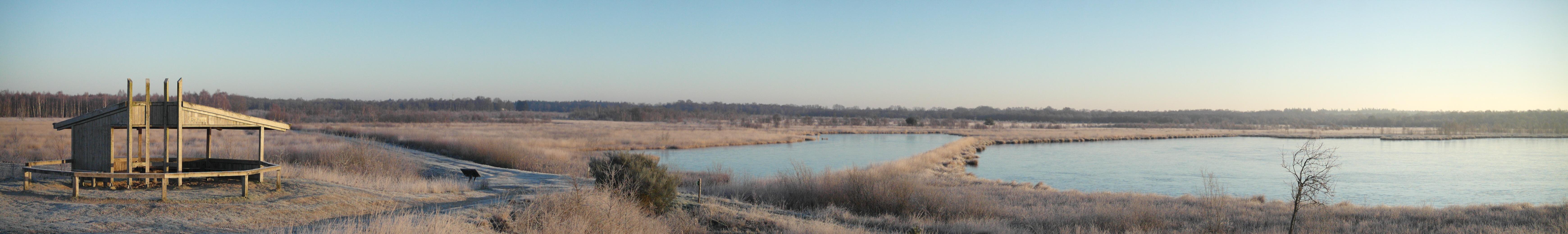 Een winters uitzicht vanaf het uitzichtpunt de Pluus.